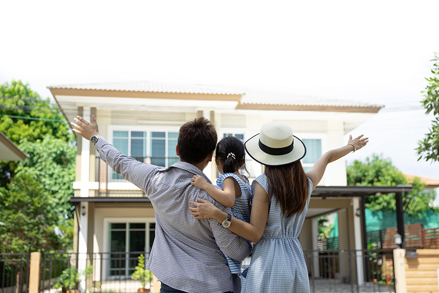 Personal Insurance - Portrait Of Excited Family Looking At Their New Home
